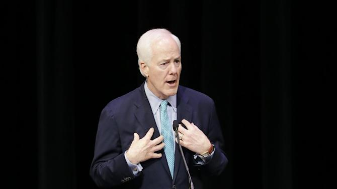 U.S. Sen. John Cornyn, R-Texas, responds to a question during a debate against Democratic U.S. Senate candidate David Alameel at Mountain View College campus, Friday, Oct. 24, 2014, in Dallas. (AP Photo/Tony Gutierrez)