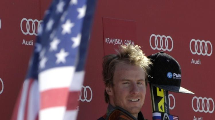 Winner Ted Ligety of the U.S listens to the national anthem after the Alpine Skiing World Cup men's giant slalom ski race in Kranjska Gora