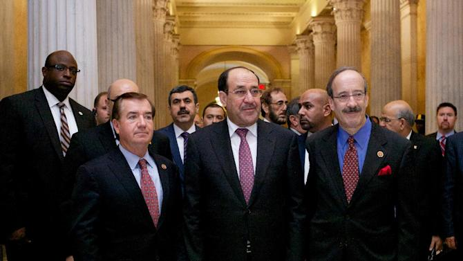 """Iraqi Prime Minister Nouri al-Maliki, center, walks with the House Foreign Affairs Committee ranking Democrat Rep. Eliot Engel, D-N.Y., right, and the committee's chairman Rep. Ed Royce, R-Calif. in Washington, Wednesday, Oct. 30, 2013, before their meeting. Al-Maliki says terrorists """"got a second chance"""" to thrive in Iraq, largely as the result of the rise of al-Qaida fighters in neighboring Syria's civil war. (AP Photo/Molly Riley)"""