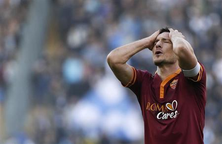 AS Roma's Totti reacts during the Italian Serie A soccer match against SS Lazio at the Olympic stadium in Rome