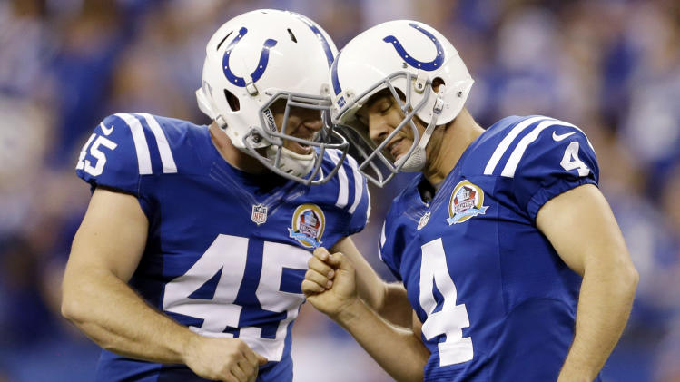 Indianapolis Colts' Adam Vinatieri (4) reacts with Matt Overton after Vinatieri kicked a 53-yard field goal during the second half of an NFL football game against the Tennessee Titans, Sunday, Dec. 9, 2012, in Indianapolis. (AP Photo/Jeff Roberson)