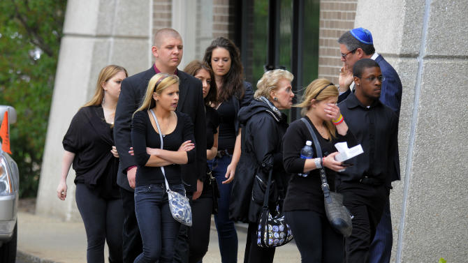 Friends and family members enter the Ira Hoffman Chapel, Tuesday, May 22, 2012, for the funeral of Jonathon Hoffman in Southfield, Mich. Hoffman, 17, was shot to death on Friday, May 18 by his grandmother Sandra Layne, 74, who is charged with with open murder and is being held without bond. An open murder charge allows a jury to decide on whether a first- or second-degree charge applies after hearing evidence.  (AP Photo/The Detroit News, Steve Perez)