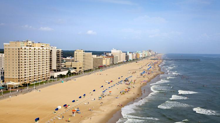 This undated photo provided by the Virginia Beach Convention and Visitors Bureau shows oceanfront beaches in Virginia Beach, Va. The wide beaches are popular with tourists in the summer and are one of a number of free things to see and do in Virginia's largest city. (AP Photo/Virginia Beach Convention and Visitors Bureau)