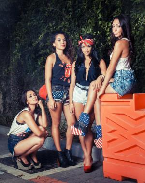 "This image released by We TV shows, from left, Jamie Hernandez, Presley Hernandez, Tahiti Hernandez, Tiara Hernandez, sisters of entertainer Bruno Mars, who will star in a reality series on We TV documenting the recording process of their debut album. ""The Lylas"" will include Tiara, Tahiti and Presley, who are moving from Hawaii to Los Angeles to join older sister Jamie. The show does not have a premiere date, but will air this fall on Fridays. It will include eight hour-long episodes. (AP Photo/We TV)"