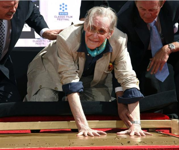 FILE - In this April 11, 2011 file photo, Actor Peter O'Toole places his handprints in cement as he is honored during the TCM Classic Film Festival at Grauman's Chinese Theatre in Los Angeles. O'T
