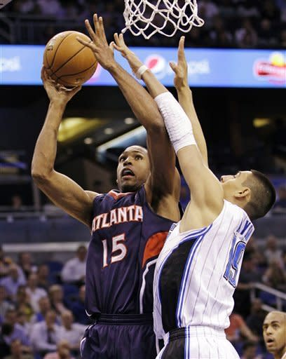 Hawks hold off late charge to beat Magic 86-80