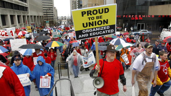 In this March 5, 2011, file photo, people protest against legislative efforts to do away with teachers' collective bargaining rights in Nashville, Tenn. The measure passed in Tennessee this year and ended collective bargaining for teachers unions in the state. (AP Photo/Mark Humphrey, File)