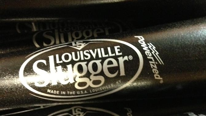 In this Thursday, March 28, 2013 photo, Louisville Slugger baseball bats are shown, in Louisville, Ky. Louisville Slugger is rolling out a new logo for the first time in 33 years on a new bat that company officials say is designed to be the hardest wooden bat ever produced at the Louisville, Ky., factory. The new logo and bat will debut on Opening Day games in Major League Baseball. (AP Photo/Brett Barrouquere)