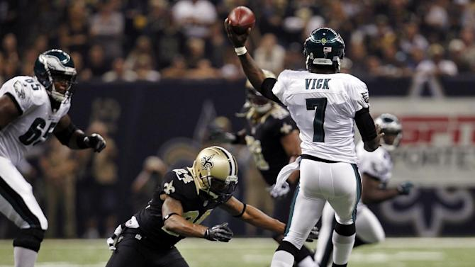 Philadelphia Eagles quarterback Michael Vick (7) passes under pressure from New Orleans Saints cornerback Corey White (24) during the first half an NFL football game at Mercedes-Benz Superdome in New Orleans, Monday, Nov. 5, 2012. (AP Photo/Gerald Herbert)