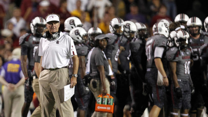 South Carolina coach Steve Spurrier looks out over the field after his team returned an interception for 70 yards against LSU in the first half of an NCAA college football game in Baton Rouge, La., Saturday, Oct. 13, 2012. (AP Photo/Gerald Herbert)
