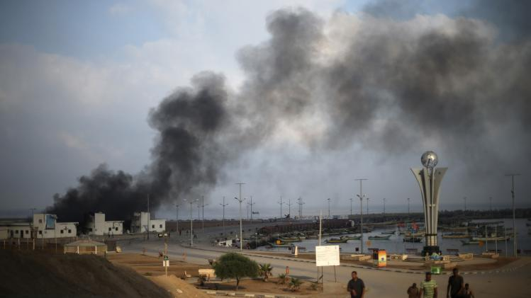 Smoke rises at the Seaport of Gaza City following what witnesses said was a shelling by the Israeli Navy