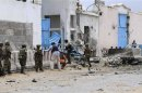 Security agents arrive to secure the UN compound following a suicide bomb attack in the capital Mogadishu