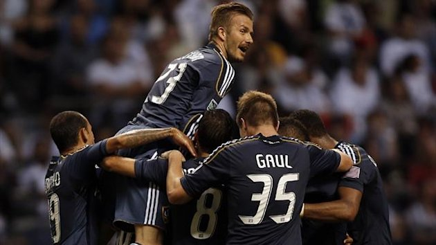 David Beckham of the LA Galaxy celebrates team-mate Jose Villarreal's goal against the Vancouver Whitecaps (Reuters)
