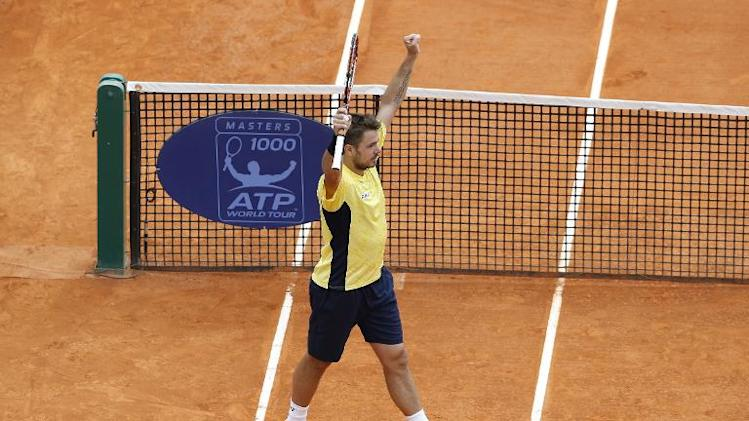 Switzerland's Stanislas Wawrinka celebrates after beating Canada's Milos Raonic on April 18, 2014 during their Monte-Carlo ATP Masters Series Tournament tennis match in Monaco