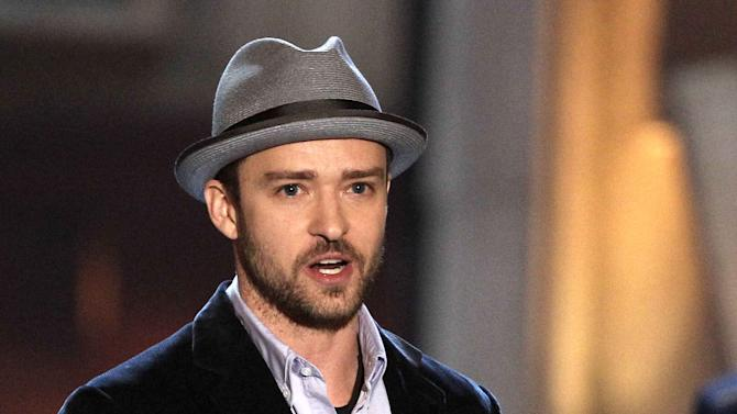 """FILE - This June 2, 2012 file photo shows actor-singer Justin Timberlake accepting the troops' choice for entertainer of the year award at the 2012 Guys Choice Awards in Culver City, Calif. Timberlake is apologizing for a video that shows homeless people offering congratulatory wishes to the pop star and his new bride, Jessica Biel. Timberlake posted an open letter on his website Friday, Oct. 26, saying he didn't know about the video or contribute to it in any way. He calls the video """"distasteful"""" and says he's deeply sorry to anyone offended by it but acknowledges it was made by well-meaning friends. The 19-second video titled """"Greetings from your Hollywood friends who just couldn't make it"""" shows three people who obviously don't know the famous couple greeting them with wedding wishes. (Photo by Matt Sayles/Invision/AP, file)"""