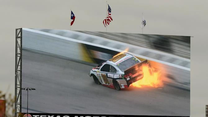 A video screen shows a replay of Dale Earnhardt Jr.'s (88) car during a wreck at the NASCAR Sprint Cup series auto race at Texas Motor Speedway, Monday, April 7, 2014, in Fort Worth, Texas