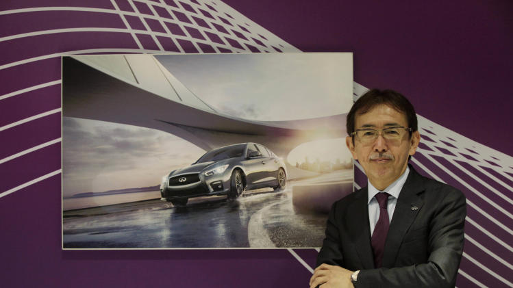 Infiniti Chief Creative Officer Shiro Nakamura poses for photographers at the Shanghai International Automobile Industry Exhibition (AUTO Shanghai) media day in Shanghai, China Saturday, April 20, 2013. (AP Photo/Eugene Hoshiko)