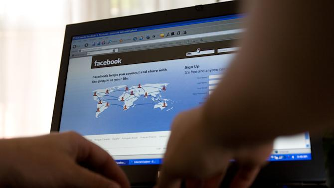FILE- In this Thursday, July 16, 2009, file photo, a Facebook user logs into their account in Ottawa, Ontario, Canada. In yet another change that irked users, Facebook has replaced the email address you picked to display on your profile page when you signed up for the online social network with an (at)facebook.com address. Previously, users may have had a yahoo.com or gmail.com address displayed, so that if people wanted to contact them outside of Facebook, they could. Sending an email to a Facebook.com address will land the email in the messages section of your Facebook profile. (AP Photo/The Canadian Press, Sean Kilpatrick)