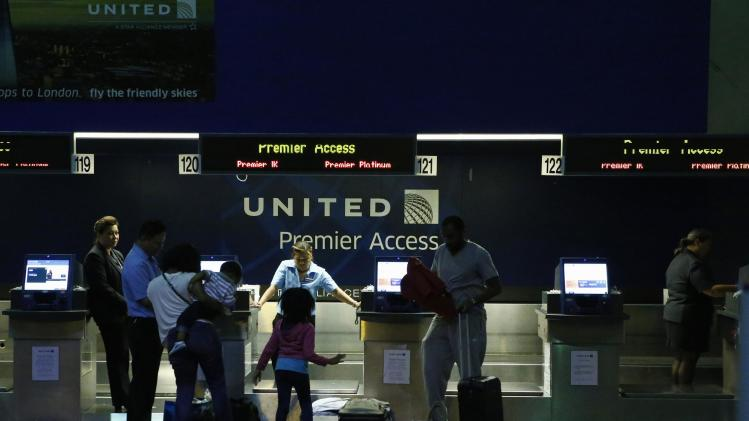 People are seen in the United Airlines terminal at Newark International Airport in New Jersey