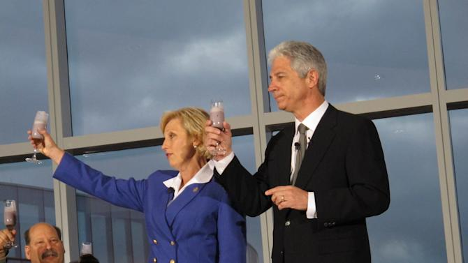 New Jersey Lt. Gov. Kim Guadagno, left, and Revel Entertainment CEO Kevin DeSanctis raise glasses of blueberry smoothies in a toast to employees at the $2.4 billion casino resort Monday, April 2, 2012, in Atlantic City, N.J. The casino resort opened Monday. (AP Photo/Wayne Parry)