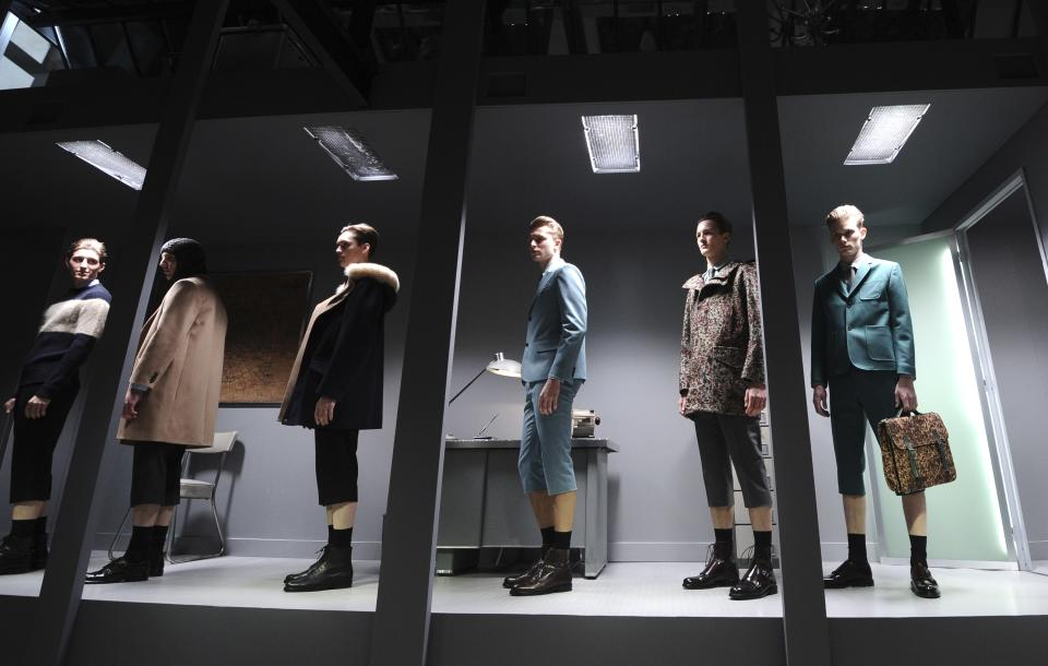 Models wear creations by French fashion designer Guillaume Henry for Carven's fall-winter 2013/2014 men's fashion collection, presented in Paris, Wednesday, Jan.16, 2013. (AP Photo/Zacharie Scheurer)
