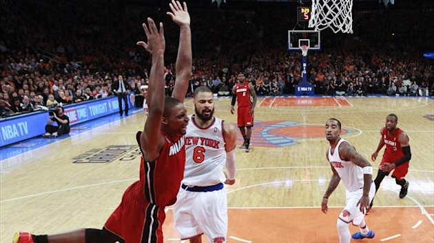 Miami Heat center Chris Bosh reacts after scoring against New York Knicks center Tyson Chandler (6) and guard J.R. Smith (R) in the fourth quarter of their NBA basketball game at Madison Square Garden in New York, March 3 (Reuters)