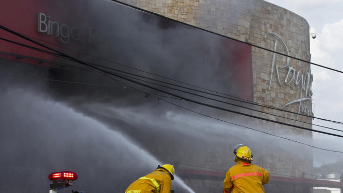 Firefighters work to extinguish a fire at the Casino Royale in Monterrey, Mexico, Thursday Aug. 25 2011. Two dozen gunmen burst into the casino in northern Mexico on Thursday, doused it with a flammable liquid and started a fire that trapped gamblers inside, killing more than 28 people and injuring a dozen more, authorities said. (AP Photo/Hans Maximo Musielik)