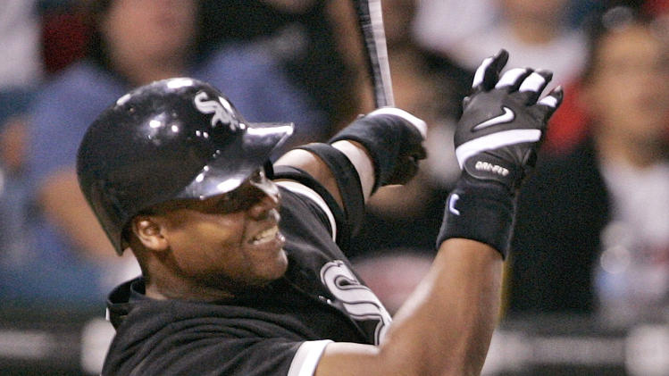 ADVANCE FOR WEEKEND EDITIONS, JULY 26-27 - FILE - In this July 5, 2005, file photo, Chicago White Sox's Frank Thomas hits a three-run home run during the eighth inning of a baseball game against the Tampa Bay Devil Rays in Chicago. Thomas will be inducted into the Baseball Hall of Fame in Cooperstown, N.Y., along with Tom Glavine, Greg Maddux and managers Joe Torre, Tony La Russa and Bobby Cox, on Sunday, July 27, 2014. (AP Photo/Brian Kersey, File)