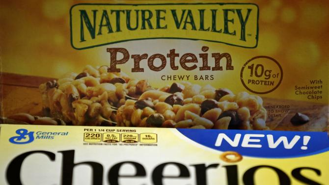 A box of Cheerios cereal and a box of Nature Valley chewy bars are seen in this photo illustration in Wilmette