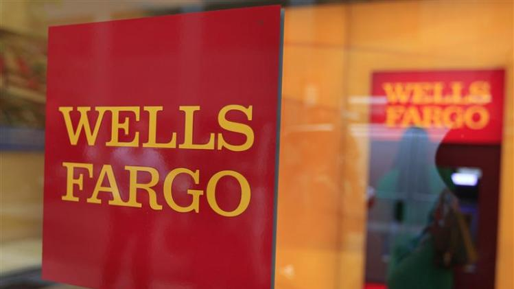 A Wells Fargo sign is seen outside a banking branch in New York