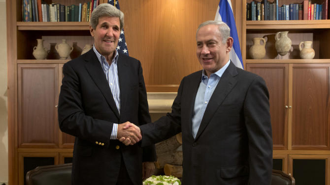 U.S. Secretary of State John Kerry, left, shakes hands with Israeli Prime Minister Benjamin Netanyahu during their meeting in Jerusalem, on Thursday, June 27, 2013. Kerry is in Israel for the fifth time in three months, to make further efforts to resume peace talks between the Jewish country and the Palestinians. (AP Photo/Jacquelyn Martin, Pool)