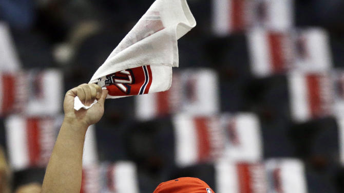 A Atlanta Hawks fane cheers before the first half in Game 3 of their first-round NBA basketball playoff series against the Indiana Pacers, Saturday, April 27, 2013 in Atlanta. (AP Photo/John Bazemore)