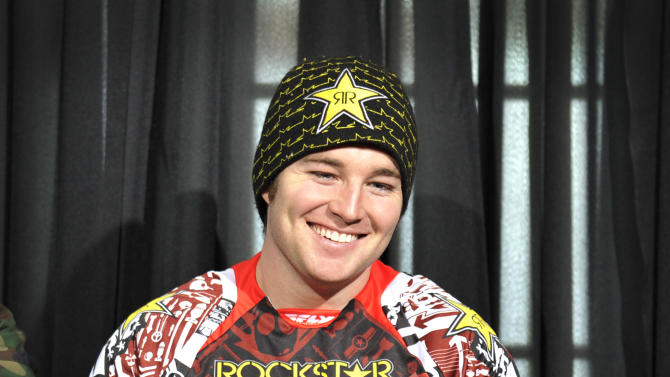 In this photo taken Jan. 25, 2012 and released by ESPN Images, snomobiler Caleb Moore smiles while attending a news conference at the Winter X Games in Aspen, Colo. Moore was in critical condition on Tuesday, Jan. 29, 2013, in a Colorado hospital after a dramatic crash at the Winter X Games in Aspen, and a relative said the family wasn't hopeful about the 25-year-old's chances for survival. (AP Photo/ESPN Images, Eric Lars Bakke)