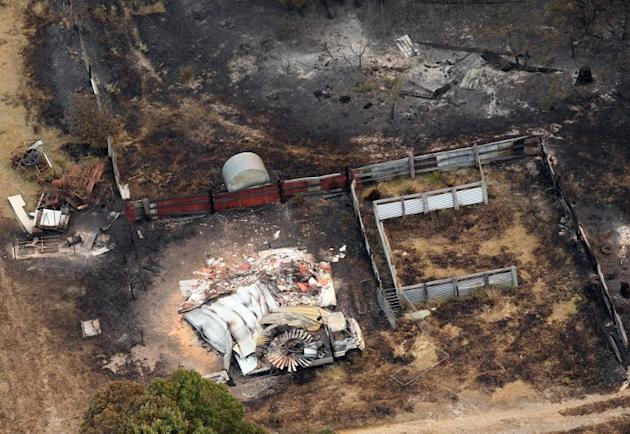 This aerial photograph taken on January 5, 2013 shows the devastation to property between Dunalley and Boomer Bay after bush fires swept through the area.  Thousands of people have fled wildfires ragi