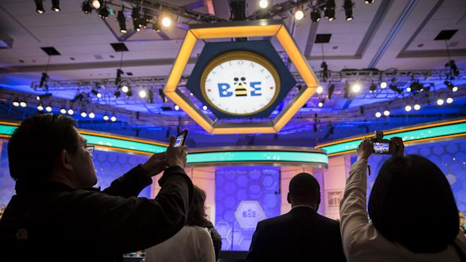 Parents photograph their children before the start of the second round at the 88th annual Scripps National Spelling Bee at National Harbor, Maryland