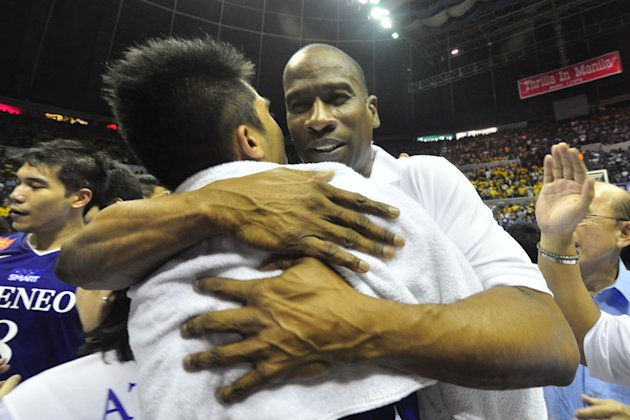 Norman Black gives one of his players a hug moments after Ateneo beat UST in Game 2 of the UAAP Finals. (NPPA Images)