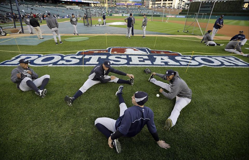 Members of the New York Yankees stretch during workouts before the start of Game 3 of the American League championship series against the Detroit Tigers Tuesday, Oct. 16, 2012, in Detroit. (AP Photo/Matt Slocum)