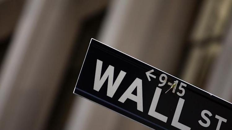 A dragonfly is seen on a Wall Street sign in New York