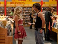 """This film image released by Warner Bros. Pictures shows Julianne Hough as Sherrie Christian, left, and Diego Boneta as Drew Boley in New Line Cinema's rock musical """"Rock of Ages,"""" a Warner Bros. Pictures release. (AP Photo/Warner Bros. Pictures, David James)"""