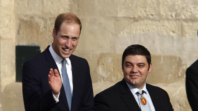 Britain's Prince William and Valletta mayor Dingli leave after watching a re-enactment of a 16th century military parade outside the Presidential Palace in Valletta