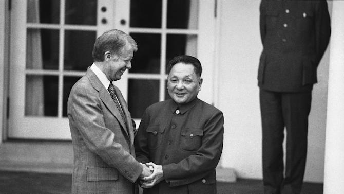 FILE - In this  Jan. 30, 1979, file photo, President Jimmy Carter and Chinese Vice Premier Teng Hsiao-ping hold hands outside the Oval Office of the White House in Washington as they met for the third time in two days for talks. (AP Photo/File)