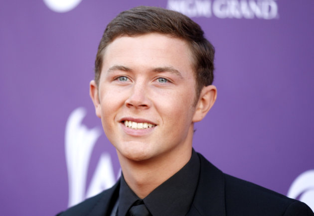 "FILE - This April 1, 2012 file photo shows Scotty McCreery arriving at the 47th Annual Academy of Country Music Awards in Las Vegas. The platinum-selling teen and former ""American Idol"" champ began his freshman year at North Carolina State University recently and he's managed to work out a schedule that allows him to balance his college education with his country music education. (AP Photo/Isaac Brekken, file)"