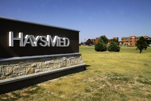 The Hays Med campus, located in Hays, Kansas, is pictured in this June 2012 photo. Officials are notifying former patients of this hospital that they may have been exposed to hepatitis C by a traveling hospital technician who's accused of causing a hepatitis C outbreak in New Hampshire. David Kwiatkowski is accused of stealing anesthetic drugs from Exeter Hospital and contaminating syringes used on patients. Officials have confirmed that Kwiatkowski worked in Arizona, Georgia, Kansas, Maryland, Michigan, New York and Pennsylvania before being hired in New Hampshire last year. (AP Photo /The Hays Daily News)