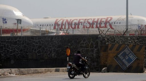 "<p>Kingfisher Airlines aircraft are seen parked inside the perimeter wall of the at the Chatrapati Shivaji International Airport in Mumbai. India's cash-strapped Kingfisher Airlines declared a ""partial lock-out"" on Monday, suspending flights for three days following alleged criminal intimidation and violence by striking employees.</p>"