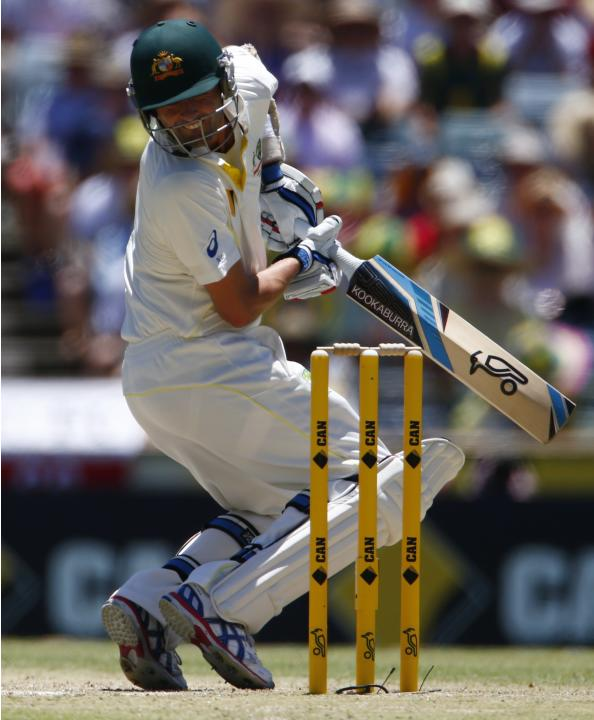 Australia's Lyon reacts as he is hit by a bouncer from England's Bresnan during the second day of the third Ashes test cricket match in Perth