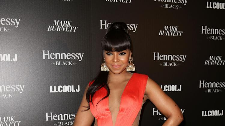 Ashanti attends Hennessy Black: A Dinner with LL Cool J and Mark Burnett Celebrating Music's Biggest Night Out, on Sat., Feb., 9, 2013 in Los Angeles. (Photo by Casey Rodgers/Invision for Hennessy/AP Images)