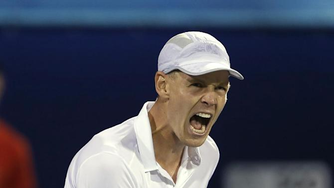 Tomas Berdych of Czech Republic celebrates winning the second set tie-break against Roger Federer of Switzerland during the semi-finals of the Dubai Duty Free Tennis Championships in Dubai, United Arab Emirates, Monday, March 1, 2013. (AP Photo/Regi Varghese)