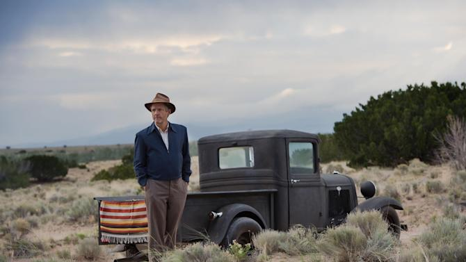 """This photo released by WGN America shows, John Benjamin Hickey as Frank Winter, in a scene from the TV series, """"Manhattan."""" The show debuts 9 p.m. ET/8 p.m. CT, Sunday, July 27, 2014, on cable channel WGN America. The drama is set in a makeshift, desolate New Mexico desert community, one of several that sprang up as part of the Manhattan Project aiming to beat Nazi Germany to the bomb. (AP Photo/WGN America, Greg Peters)"""