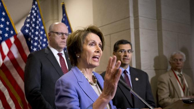 House Minority Leader Nancy Pelosi of Calif., center, flanked by Rep. Joseph Crowley, D-NY, left, and Rep. Xavier Becerra, D-Calif., gestures during a news conference on Capitol Hill in Washington, Tuesday, Jan. 1, 2013, to discuss the fiscal cliff bill passed by the Senate last night that's waiting for a vote in the Republican-controlled House. The House Democrats met earlier with Vice President Joe Biden who has been shuttling between the White House and Capitol Hill to help negotiate a legislative path to avert the across-the-board tax increases and sweeping spending cuts that could damage the economy.  (AP Photo/J. Scott Applewhite)