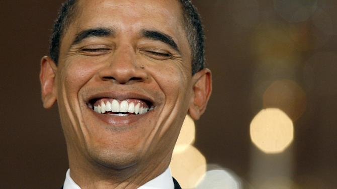 FILE - In this Feb. 9, 2009, file photo, President Barack Obama laughs during his first prime time televised news conference in the East Room of the White House in Washington. Five years into his presidency, the verdict on Obama is: nice guy, so-so president. A new AP-GfK Poll finds that less than a third of Americans consider Obama to be an above-average president. But nearly twice as many find him likable. (AP Photo/Charles Dharapak, File)